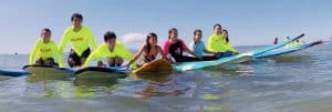group of kids on surf boards